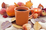 Orange coffee cup on the autumn fall leaves