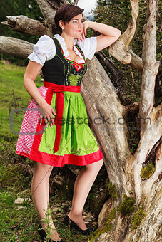 Beautiful girl in a dirndl dreams  by herself