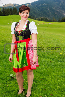 Beautiful woman in a colourful dirndl