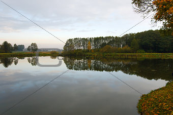 Autumn landscape with water and reflection
