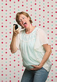 Pregnant Woman Yelling at Phone