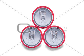 three aluminum drink cans shadow
