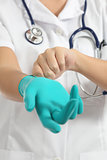 Close up of a female doctor putting latex gloves