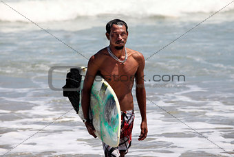 Surfer on a coastline