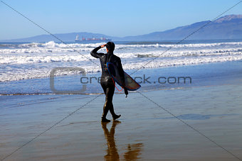Surfer on a coastline