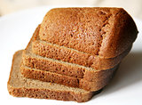 Borodino rye bread sliced on white plate