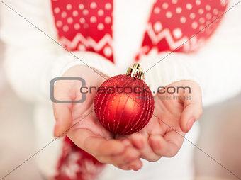 Toy ball on palms