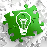 Light Bulb Icon on Green Puzzle.