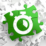 Stopwatch Icon on Green Puzzle.