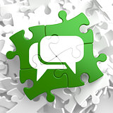 White Speech Bubble Icon on Green Puzzle.