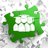 Group of Graduates Icon on Green Puzzle.