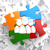 Group of Graduates Icon on Multicolor Puzzle.