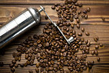 metal grinder with coffee beans