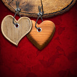 Two Wooden Hearts on Red Floral Background