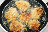 Potato Pancakes - Latkes Frying in Oil