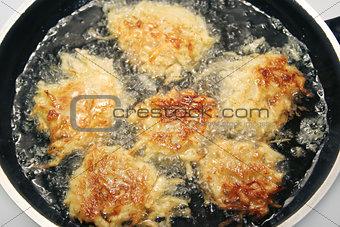 Potato Pancakes - Latkes Frying in Oil