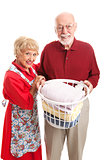 Senior Couple Doing Laundry Together