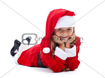 Happy girl in Santa outfit smiling