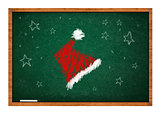 Santa Claus hat on green chalkboard