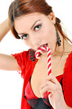Sexy woman licking lollipop.