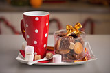 Closeup on plate with christmas cookies and cup of hot chocolate