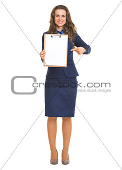 Full length portrait of smiling business woman pointing on blank