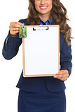 Closeup on happy realtor woman with keys showing blank clipboard