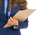 Closeup on business woman with clipboard
