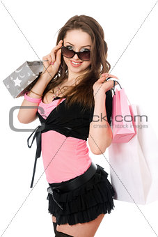 Portrait of happy young woman after shopping