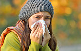 girl with allergy or cold using tissue