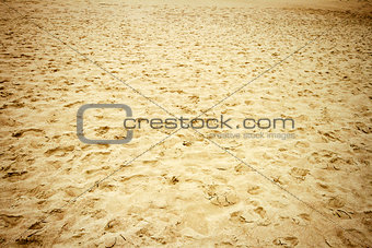 Footsteps on a beach sand