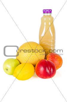 Fresh bottle of juice with fruits isolated on white