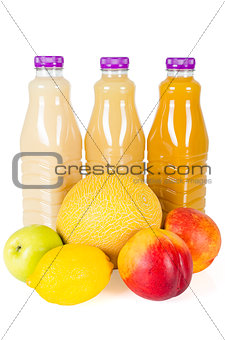 Fresh bottles of juice with fruits isolated on white