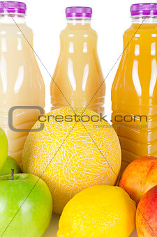 Fresh bottles of juice with fruits isolated on white