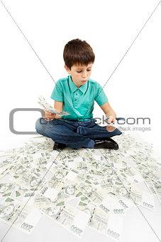 boy sitting on money