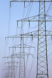 Electricity pylons in a row