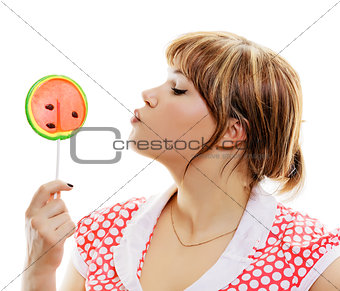 attractive girl with a round lollipop