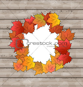 Autumn leaves maple with copy space, wooden texture