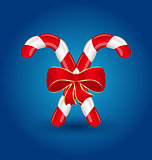 Christmas candy canes with red bow isolated