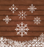 Set snowflakes on wooden texture