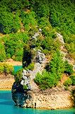 Rocky island in a mountain lake