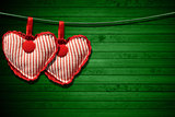 Red Cloth Hearts on Green Wood Background