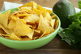 corn chips (nachos) in a green bowl