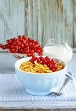 healthy breakfast granola corn with red currant (in blue bowl)