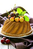 festive round sponge cake with berries cherry