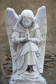 Angel on tombstone on old cemetery