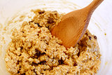 Mixing oatmeal raisin cookie dough