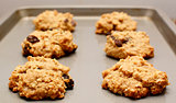 Oatmeal raisin cookies cooling on a baking sheet
