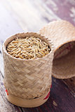 pile of unmilled paddy grains in bamboo basket