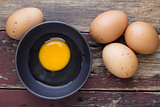 Fresh eggs on wood background